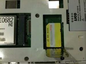 Open SIM card holder with SIM card